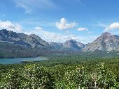 Beautiful mountains and valleys on a clear, sunny day in Glacier National Park.