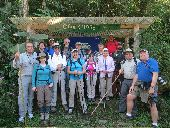 Large group poses for a picture near a trailhead in Cloudbridge Preserve.