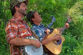 The Okee Dokee Brothers perform on the banks of the Mississippi River on a WI day trip.