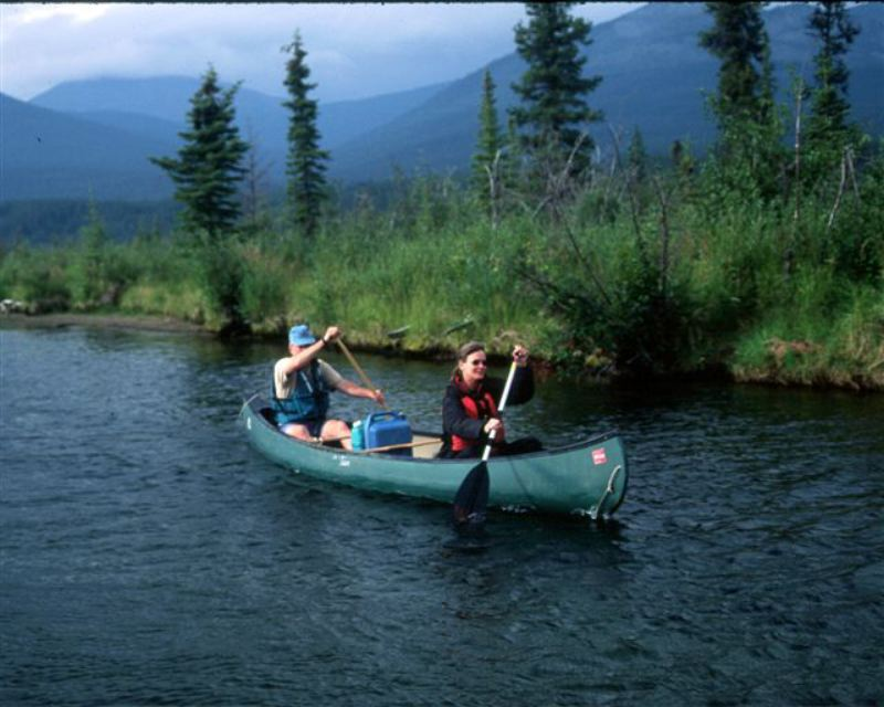 Canoeing on the yukon river with the big salmon range in the