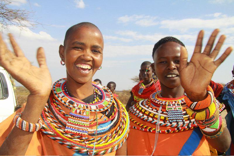 Kenyan Clothing For Women Two masaai women wave to the