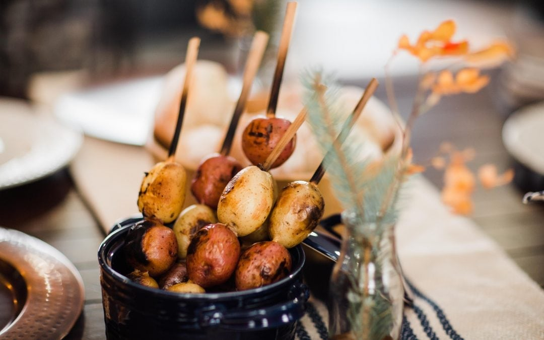 Cedar Skewered Patatas Bravas With Cranberry Almond Romesco