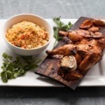 Red Oak Planked Harissa Spatchcocked Game Hen with Cumin Couscous Salad