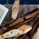 Alder Wrapped Sausages with Shallots, Mustards and Grilled Baguette