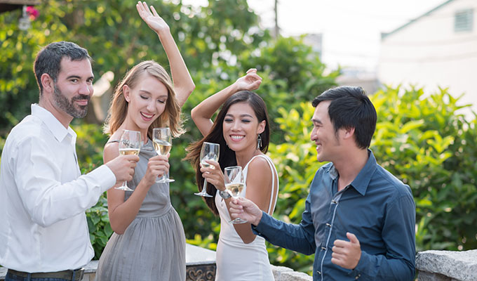 drinking champagne with friends