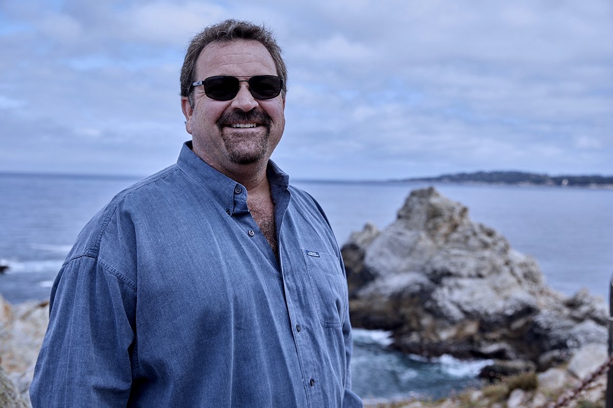 """Winemaker David Coventry stands along the coast of Monterey, which plays a significant role in the AVA's climate."""