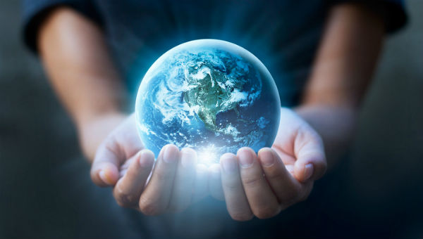 Kid holding Earth 600 x 340.jpg