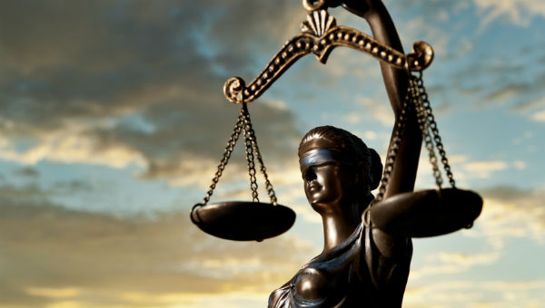 Lady Justice with sky background 600 x 340.jpg