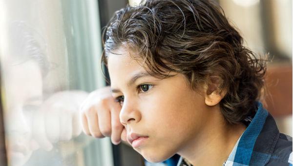 sad child looks thru window 600 x 340.jpg