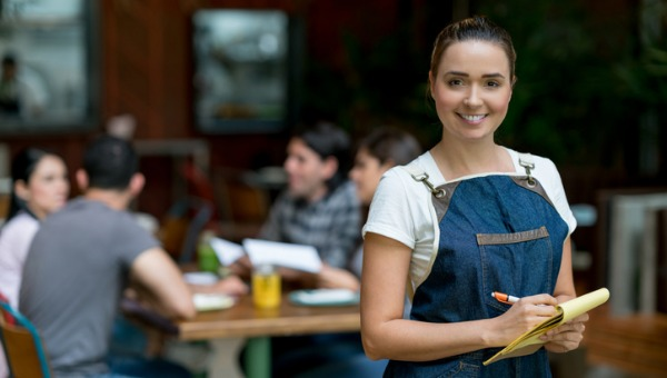 waitress-working-at-a-restaurant-holding-a-notepad-picture-id960567946.jpg