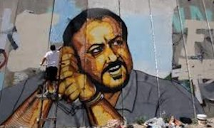 Marwan Barghouti's image painted on the Palestinian side of the Israeli security barrier