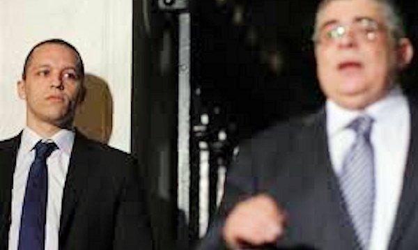 Ilias Kasidiaris (left) listening to Golden Dawn leader Michaloliakos