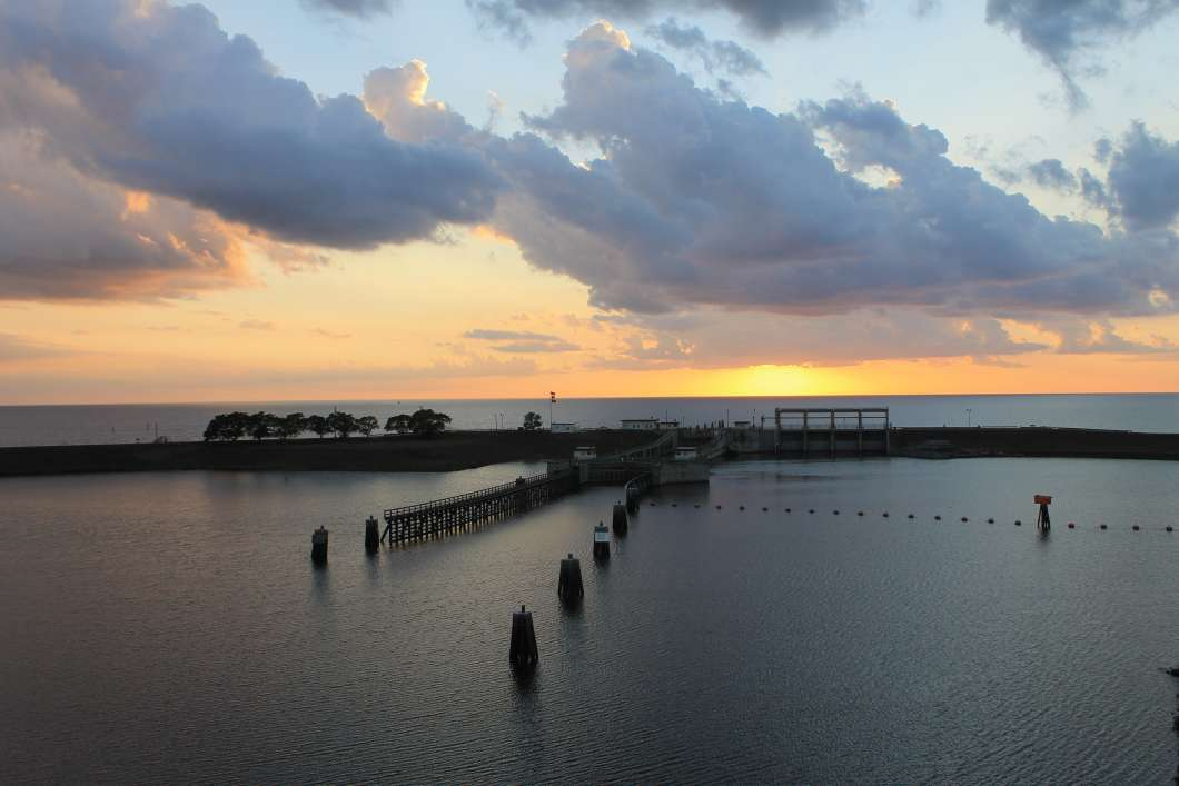 The sun sets behind the lock and dam on Lake Okeechobee and St. Lucie Canal. Photo by Amy Green