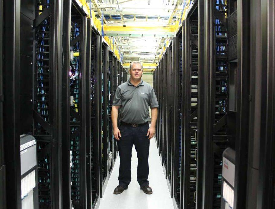 Chad Koon inside the equipment room at Verizons Orlando superswitch. Photo: Matthew Peddie, WMFE