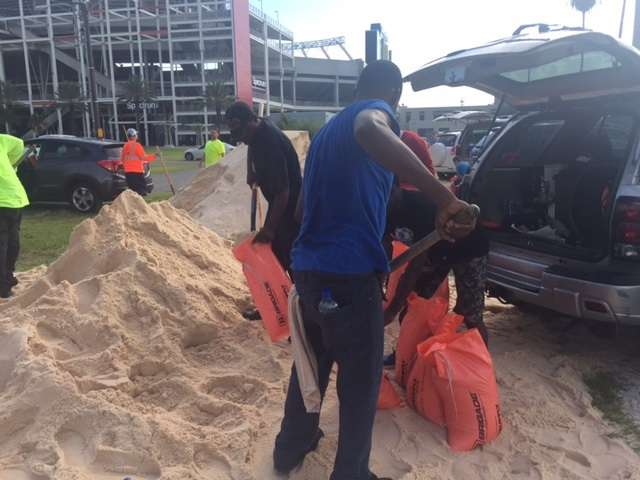 Orlando residents  fillling sandbags at Camping World Stadium in 2017./Photo: Catherine Welch