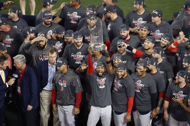 The Boston Red Sox celebrate their 5-1 victory over the Los Angeles Dodgers in Game 5 to win the 2018 World Series at Dodger Stadium on Sunday night. Ezra Shaw/Getty Images