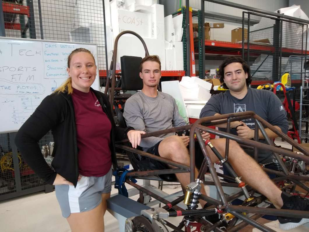 Florida Tech seniors (L to R) Emily York, Curtis Thies and Filippo Mazzanti are working on a race car for their senior design project. Photo: Brendan Byrne
