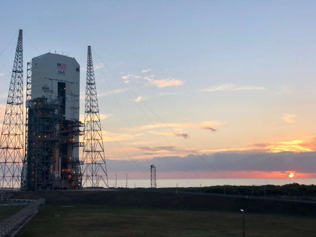 The sun  rising over the ULA's DeltaIV with WGS-10 on the launch pad Friday. Photo: ULA