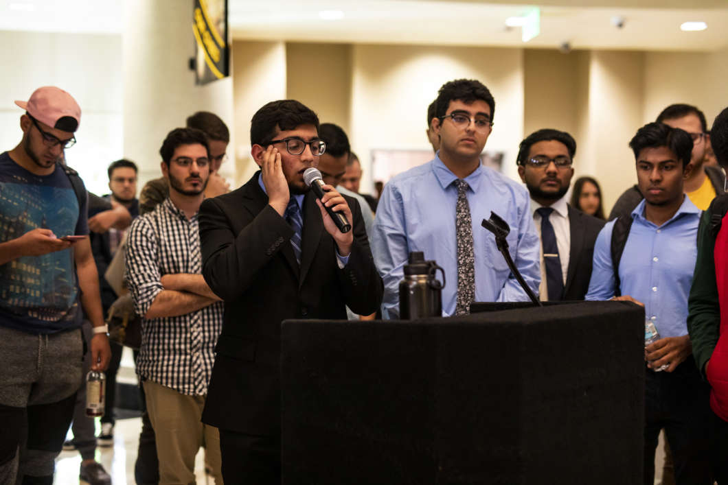 Student imam Abdullah Saqib led the call to prayer at the University of Central Florida vigil for the victims of the Christchurch shooting. (Rachel Harris, UCF)