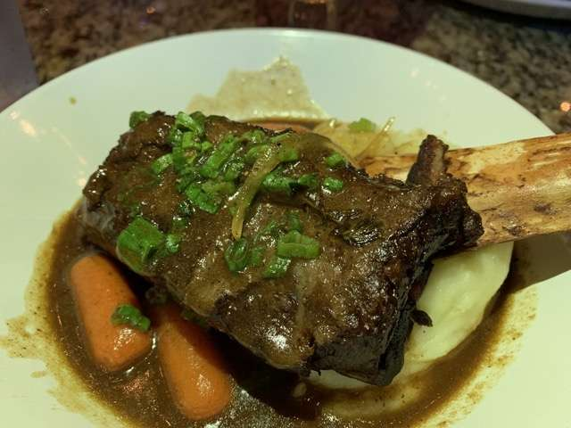 "For my entree I selected that Short Rib Carbonnade, described as a ""hearty Belgian dish"" with a large braised rib with a gravy infused with beer, mustard and gingerbread.  Photo: Scott Joseph"