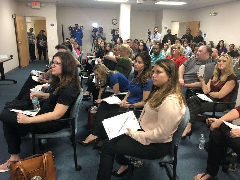 Providers and parents fill the room of AHCA's Tampa field office for a public meeting about proposed changes to behavior analysis therapy through Florida Medicaid. Future meetings will be held in webinar form. via DAYLINA MILLER / WUSF PUBLIC MEDIA