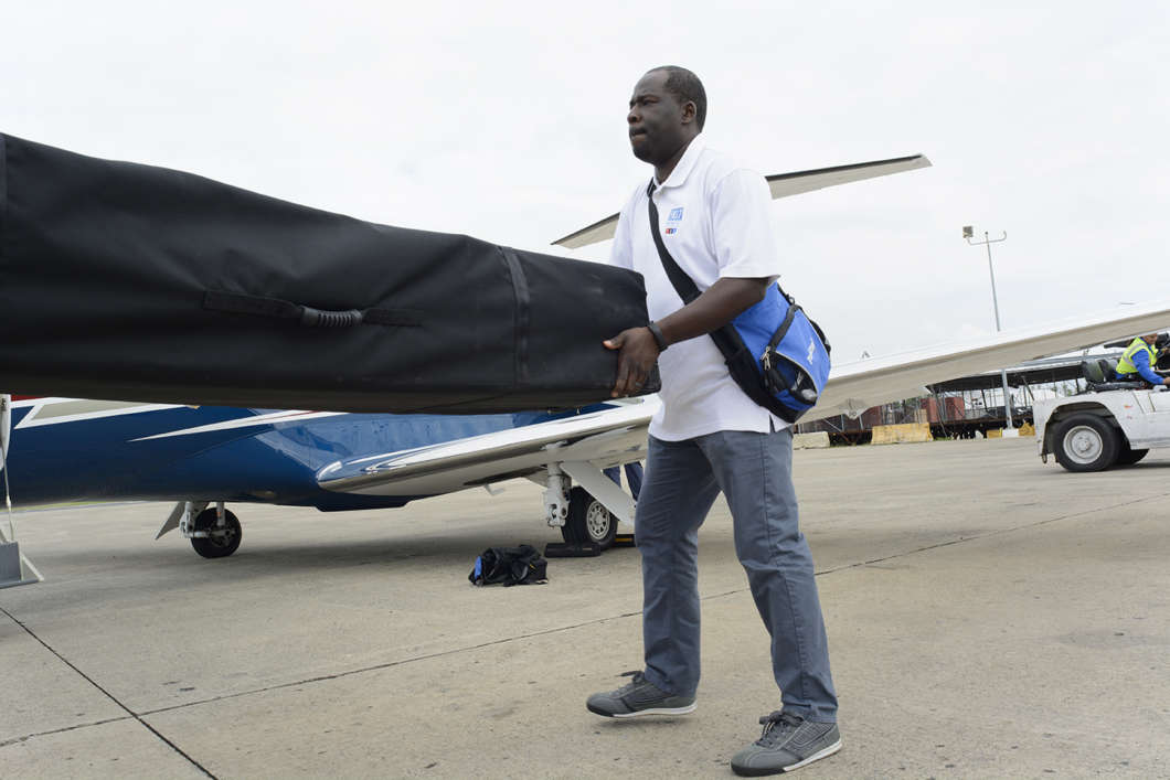 LaFontaine Oliver unloading a portable radio transmitter at an airport in San Juan, Puerto Rico, in October 2017. The equipment was destined for a public radio station in Puerto Rico who lost power after Hurricane Maria. Photo: Eric Breitenbach