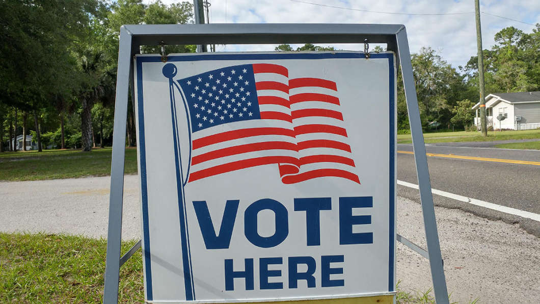 A sign directing people to a Jacksonville voting precinct is pictured. Photo: Bill Bortzfield / WJCT News