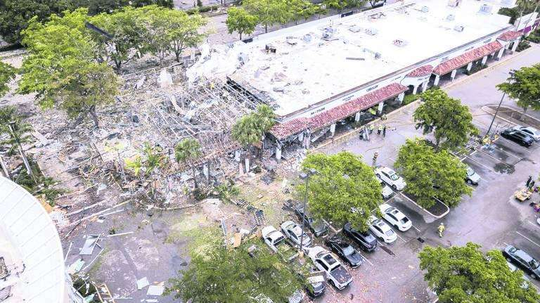 A gas explosion at Pizzafree, a pizza parlor across from the Fountains Plaza in Plantation, on Saturday, July 6, injured 23 people and caused the windows to blow out at LA Fitness. via MATIAS OCNER / MIAMI HERALD