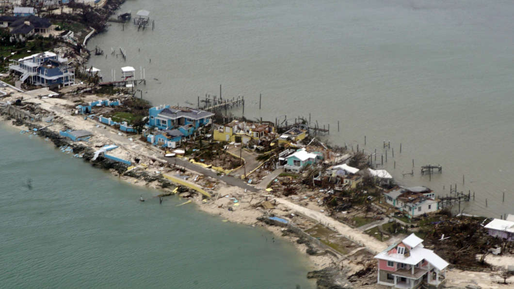 Overhead view of a row of damaged structures in the Bahamas from a Coast Guard C-130 aircraft. U.S. Coast Guard photo by Petty Officer 2nd Class Adam Stanton. Photo: NPR News