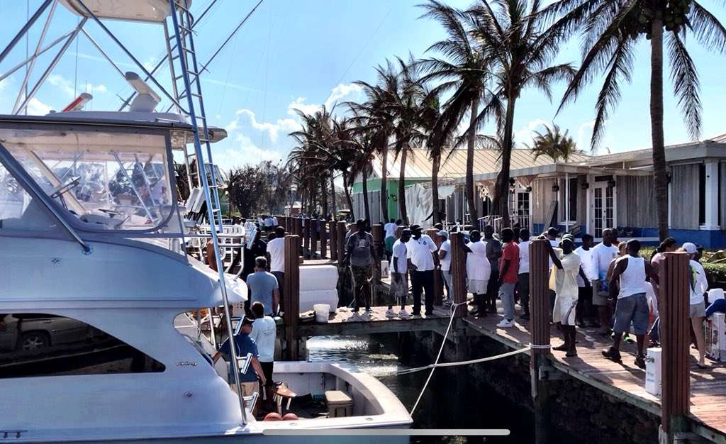 Fisherman unload supplies after traveling to the Bahamian islands from Florida. Photo: Paul Brinkmann / UPI