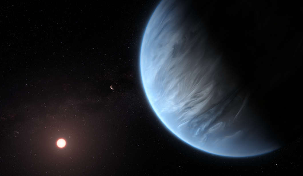 This artist's impression shows the planet K2-18b, it's host star and an accompanying planet in this system.  Photo:  ESA/Hubble, M. Kornmesser