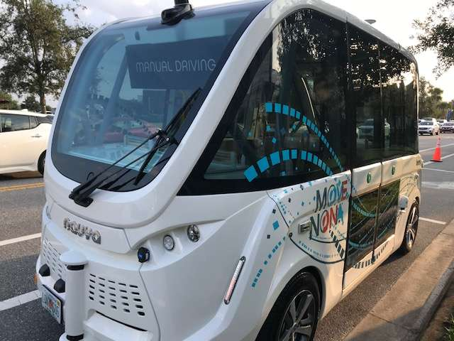A Beep shuttle is parked at the Village Green in Lake Nona. Photo: Danielle Prieur