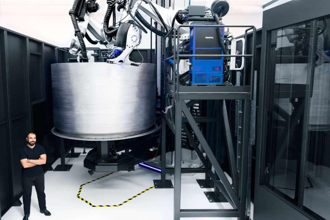 Relativity Space's Jordan Noone next to his company's 3D rocket printer. Photo: Relativity Space