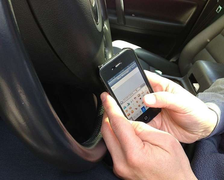 Image: Texting while driving via Intel Free Press/Wikimedia Commons