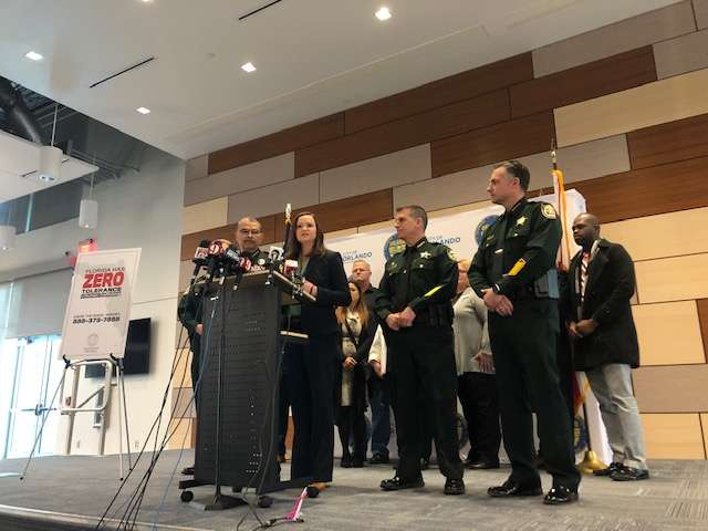Orlando Police Chief Orlando Rolón, Attorney General Ashley Moody, Orange County Sheriff John Mina and Seminole County Sheriff Dennis Lemma (L to R) speak at a press conference Tuesday, Jan. 21 discussing anti-human trafficking efforts ahead of the Pro Bowl this weekend. Photo: Rachel Smith/WMFE