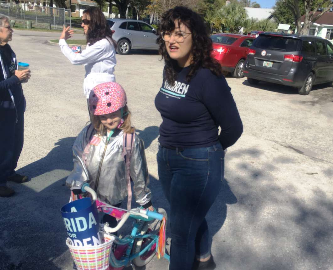 Kas Miller and her daughter, Lila, at the Elizabeth Warren canvassing kickoff in Tampa Steve Newborn WUSF Public Media