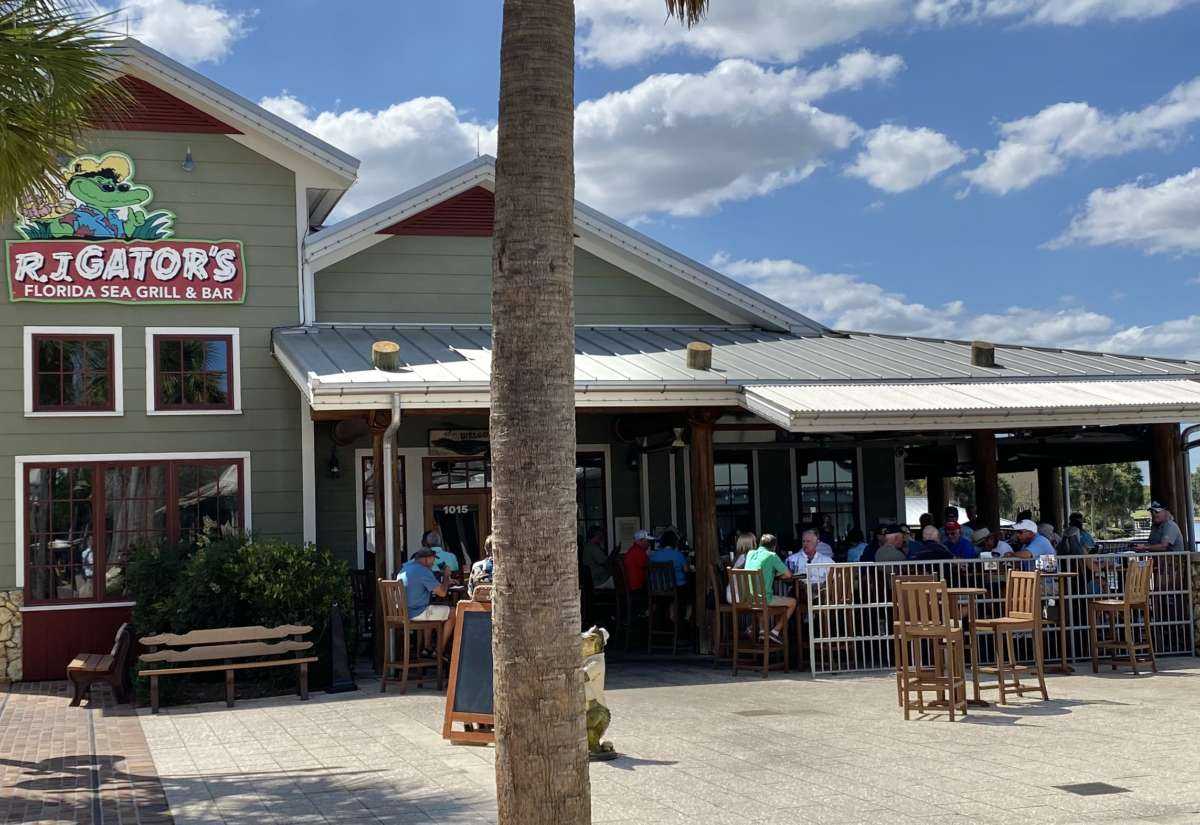 Customers pack the patio bar and tables at RJ Gators in Lake Sumter Landing in The Villages Friday afternoon. Photo: Joe Byrnes