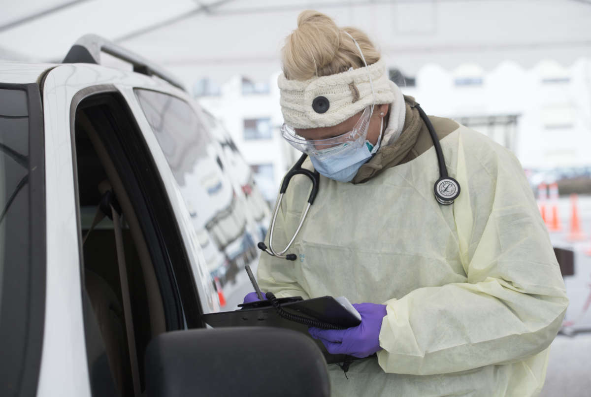 File photo: Medical technician writes down patient information during COVID-19 testing. Photo: U.S. Air Force