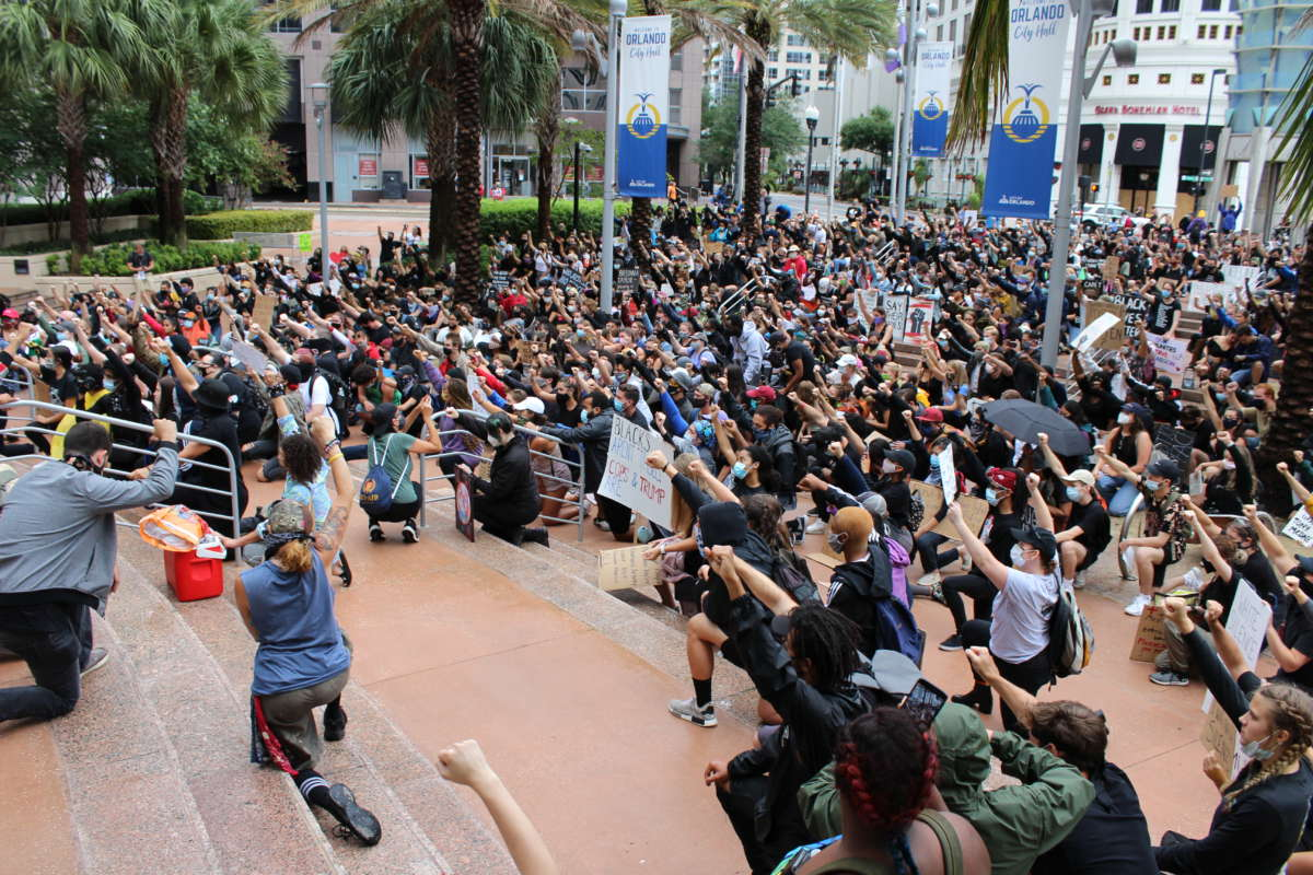 Protesters kneel in front of Orlando City Hall. Thursday, 06/04/20 . Photo: Matthew Peddie, WMFE