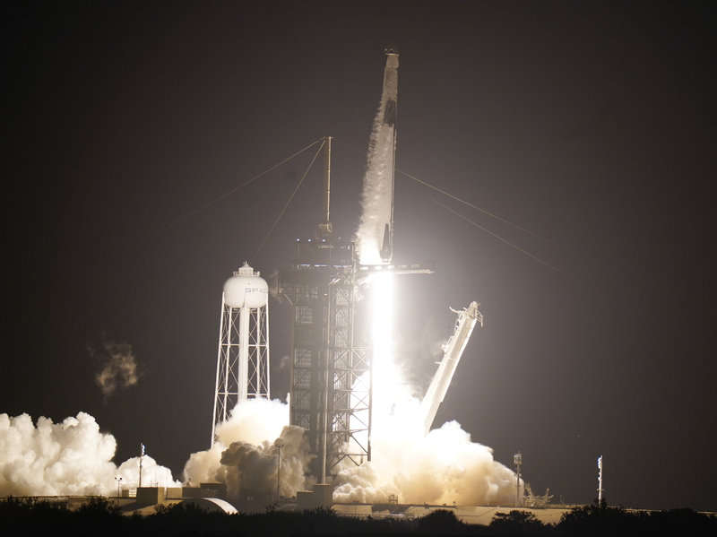 A SpaceX Falcon9 rocket, with the Crew Dragon capsule attached, lifts off from Kennedy Space Center's Launch Complex 39-A Sunday Nov. 15, 2020, in Cape Canaveral, Fla. Four astronauts are beginning a mission to the international Space Station. (AP Photo/John Raoux)