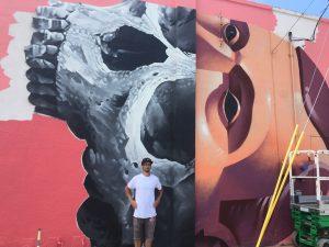 Michael Reeder & his Shine mural in progress