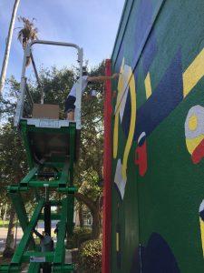 Daniel Mrgan working on his mural