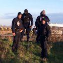 Police in Calais near where refugees sleep