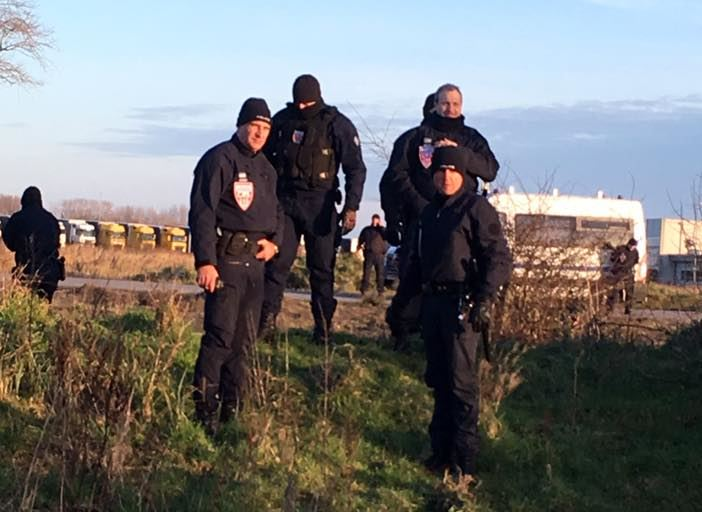Police in Calais near where refugees sleep