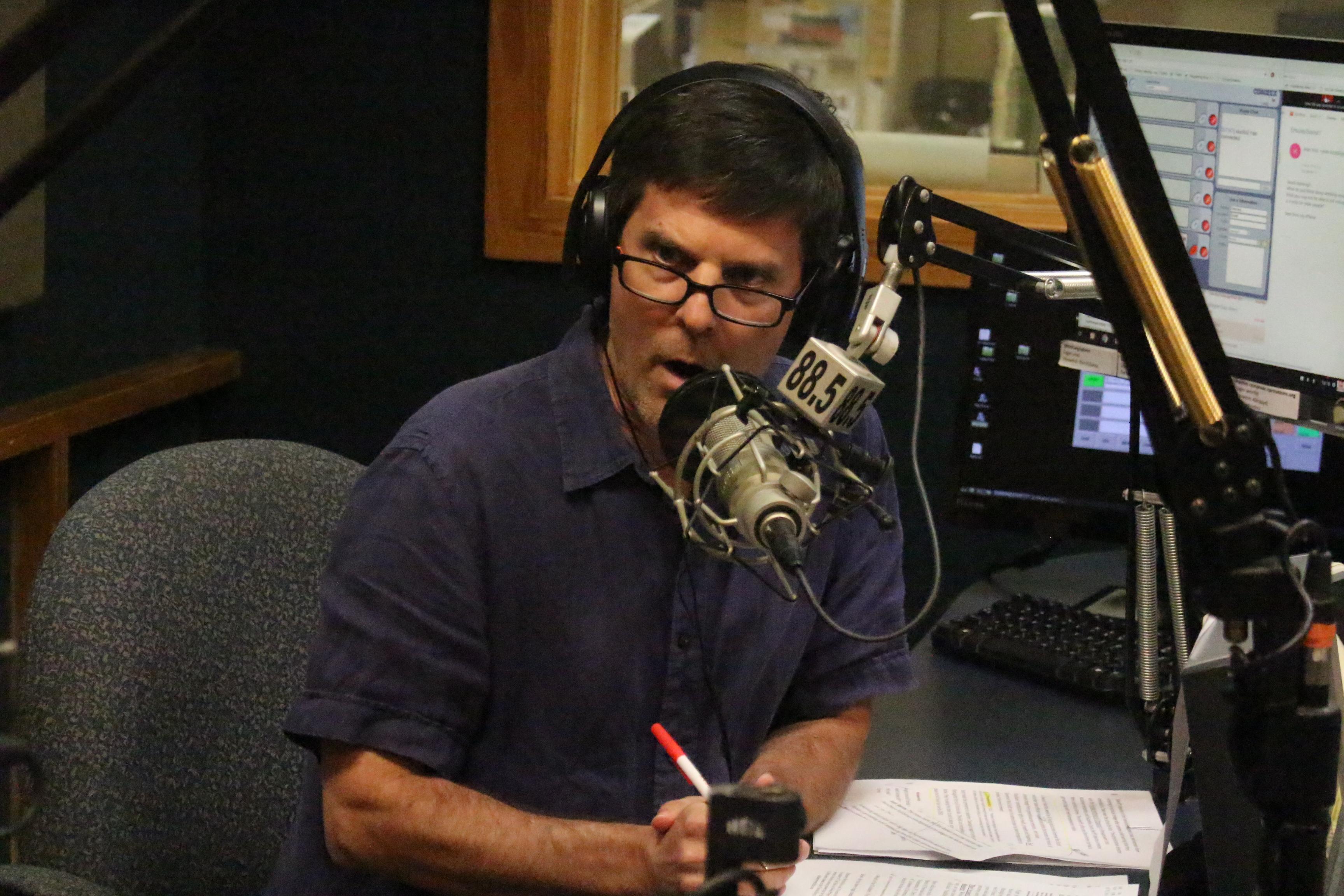 WMNF News MidPoint host Seán Kinane