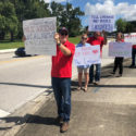 Ledger workers hold signs in Lakeland