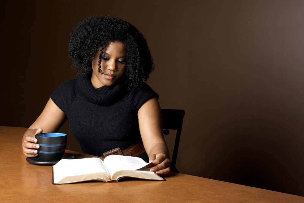 Young woman with coffee & bible