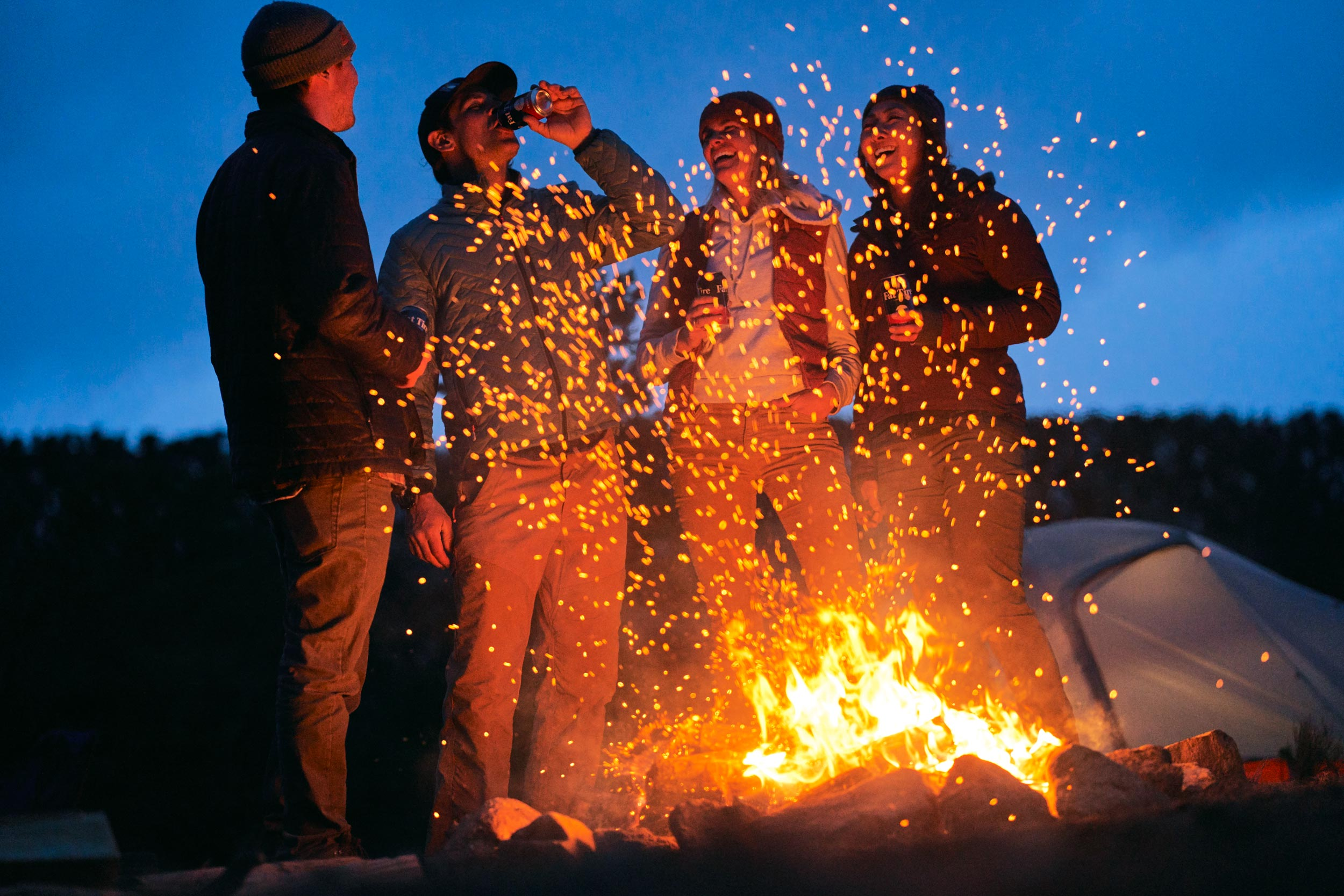 Andrew Maguire photographs friends around a campfire for a Fat Tire campaign in Colorado for New Belgium Brewing.