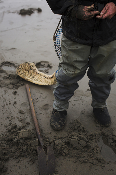 RIchard Darbonne photographs Nevas shoes in the wet sand as he works for 1859 Magazine