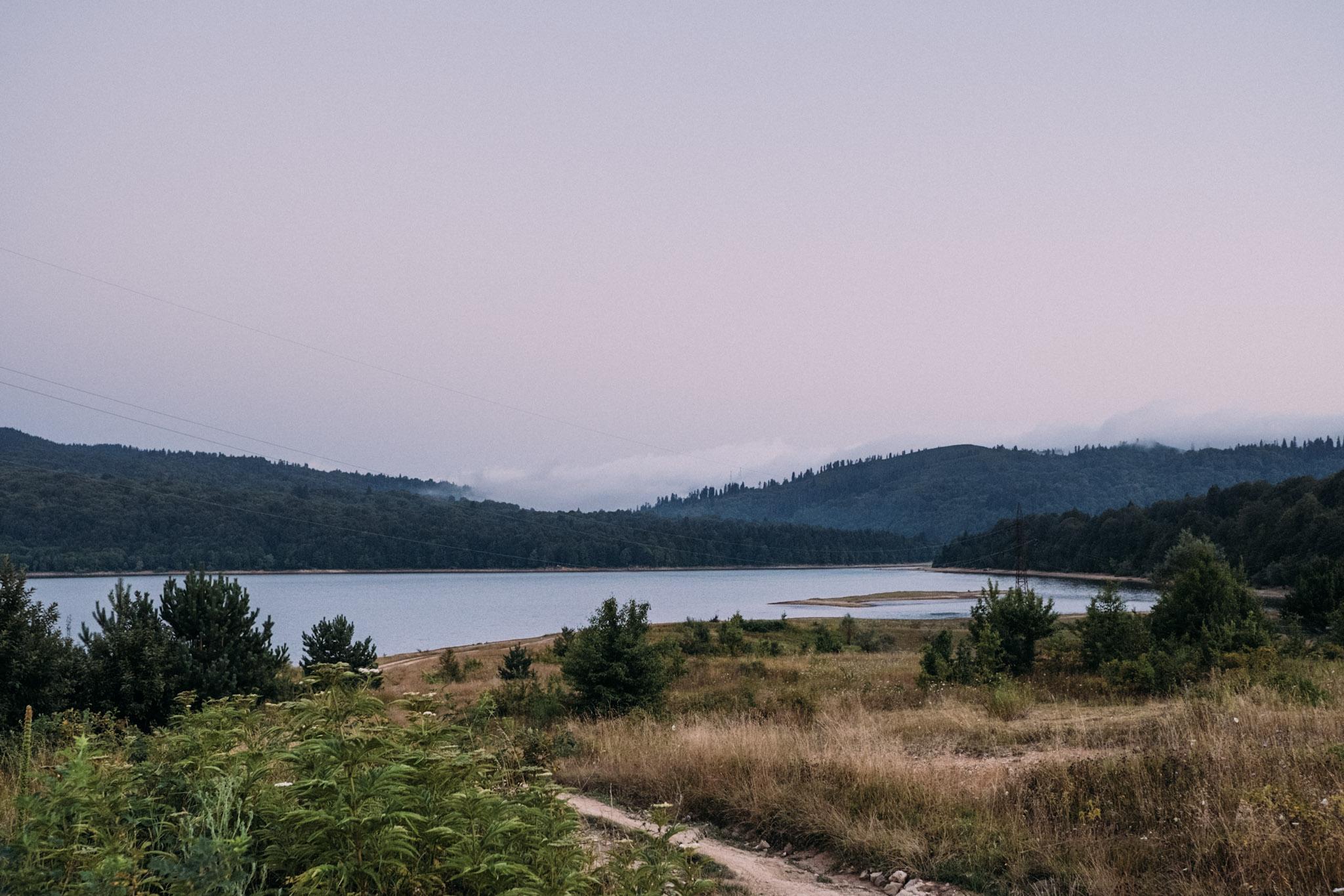 Shaori Lake in Georgia is shown under a cloudy sky in this photograph by Dimitri Mais
